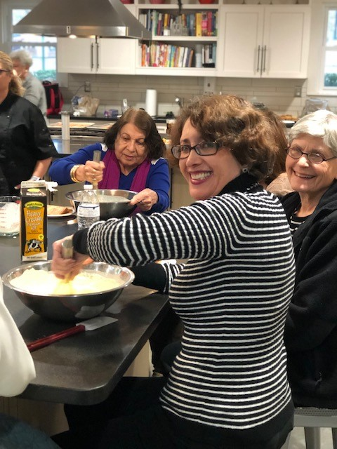 A group of AgeWell community members at a cooking class