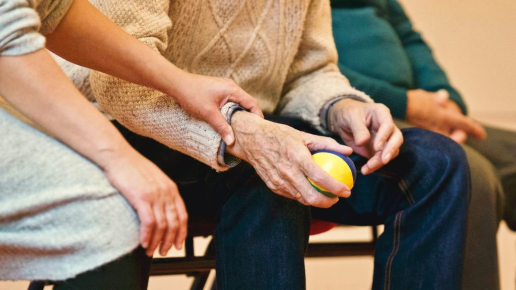 A caregiver helping an AgeWell community member