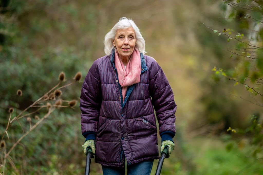 An AgeWell community member out for a walk outside